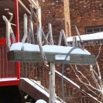 wood& rail  sculpture i the snow EH
